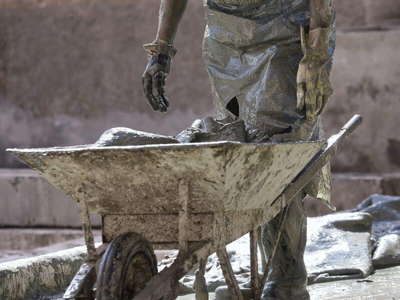Man and wheelbarrow with concrete