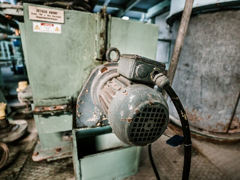 Old air compressor in a factory